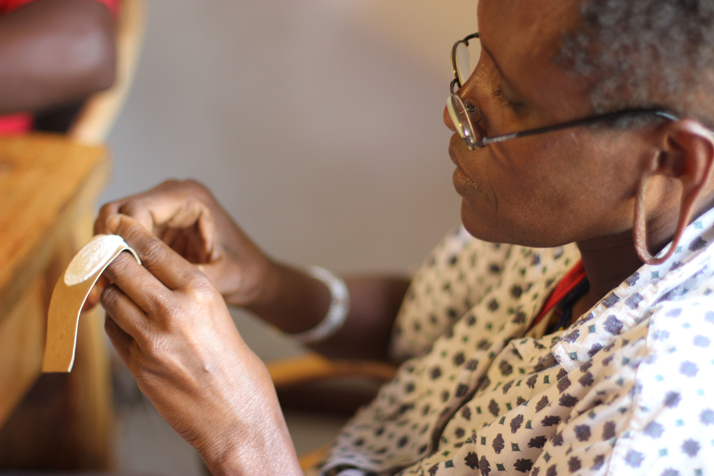 Sidai artisan beads on to leather